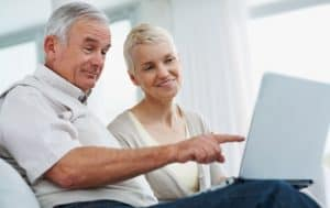 A retired couple review their investing portfolio